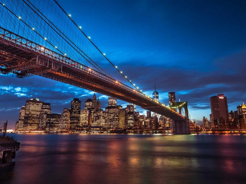 Brooklyn Bridge and lower Manhattan skyline at dusk, New York