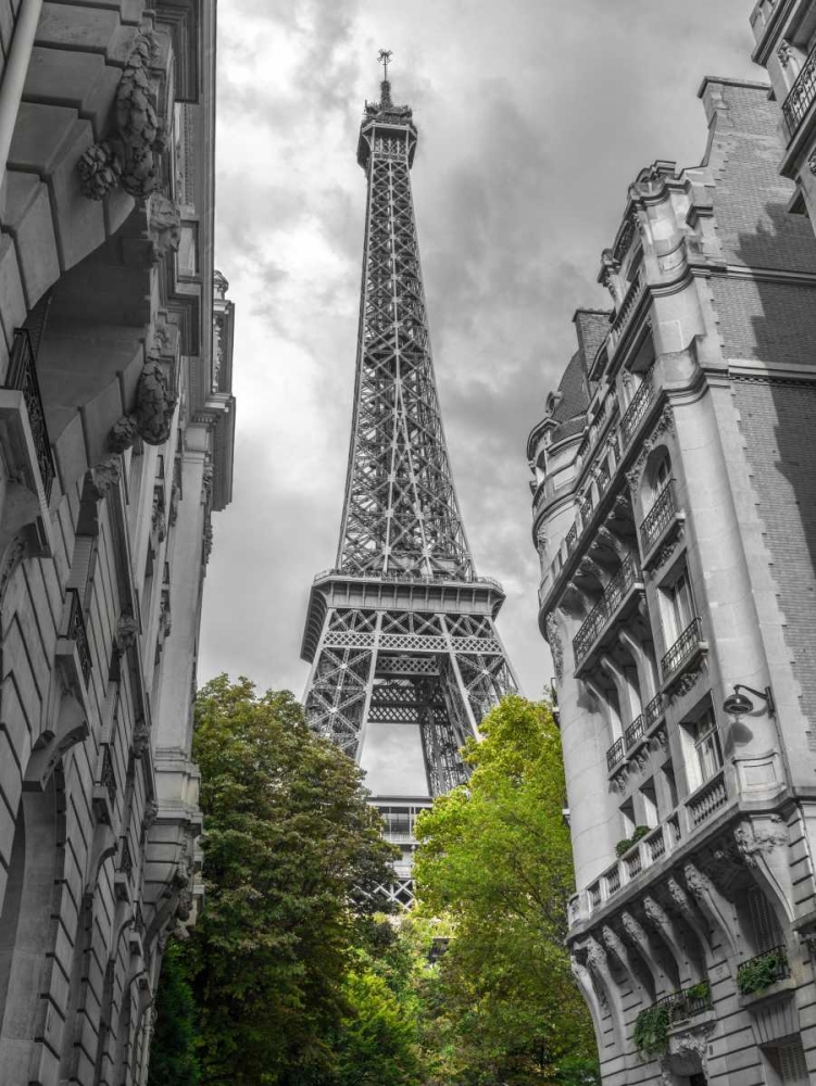 View of Eiffel Tower from a narrow street in Paris, France