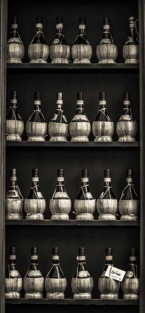 Old wine bottles on wooden shelf