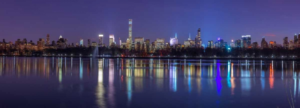 View of New York city skyline from Central park in evening