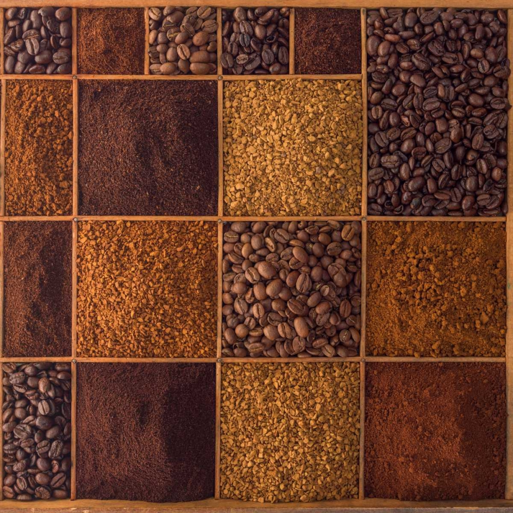 Variety of coffee beans in a wooden box