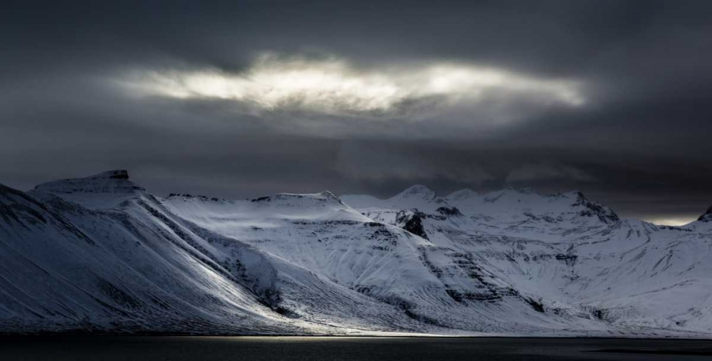 Iceland Sunlight bursts through storm clouds
